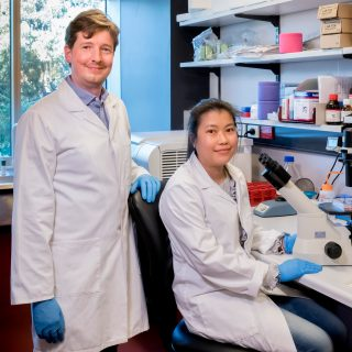 Dr Robin Hobbs in the lab with PhD student Mai La.
