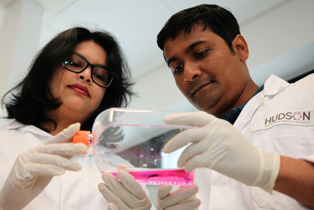 Shayanti and Kallyanashis holding stem cells conducting POP research at Hudson Institute