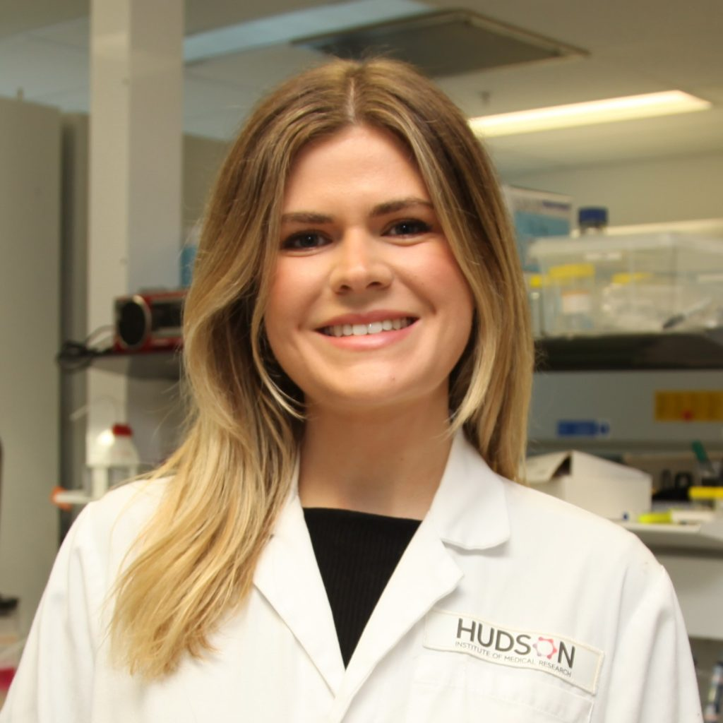 Madeleine Smith in a lab coat at Hudson Institute